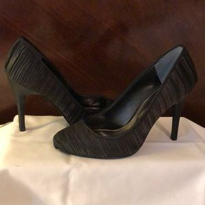 Black pleated satin heels. Size 7.5